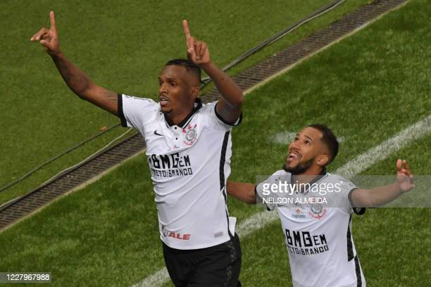 Jo of Corinthians celebrates with a teammate after scoring against Palmeiras during the Paulista championship final football match at the Allianz...