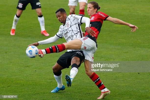 Jo of Corinthians fights for the ball against Filipe Luis of Flamengo during a match between Corinthians and Flamengo as part of Brasileirao 2021 at...