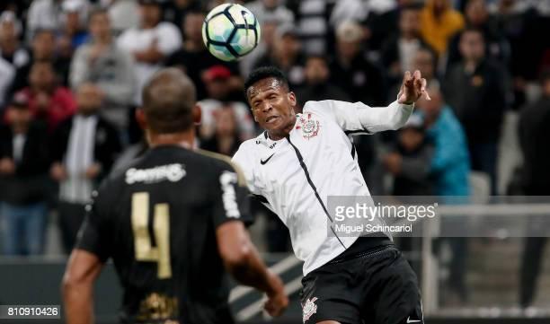 Jo of Corinthians vies for the ball with Rodrigo of Ponte Preta during the match between Corinthians and Ponte Preta for the Brasileirao Series A...