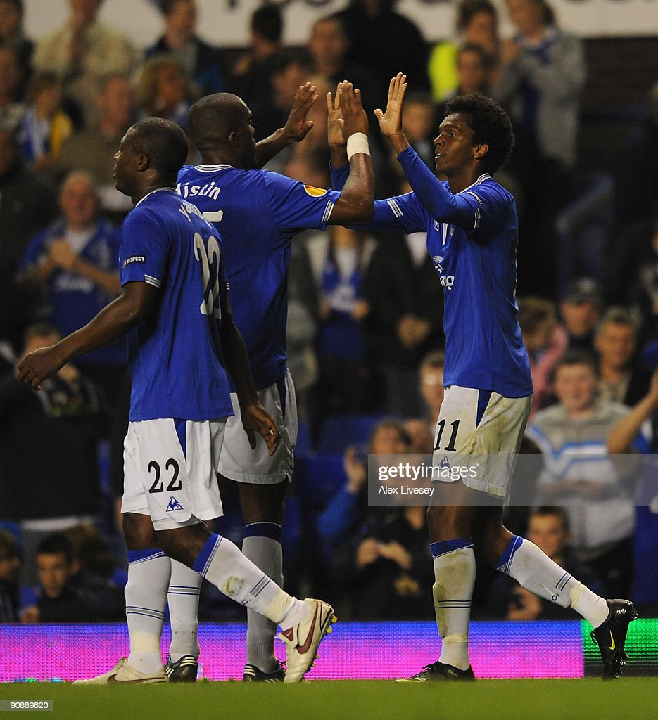 Jo of Everton celebrates with Sylvain Distin after scoring the fourth goal during the UEFA Europa League Group I match between Everton and AEK Athens at Goodison Park on September 17, 2009 in Liverpool, England.