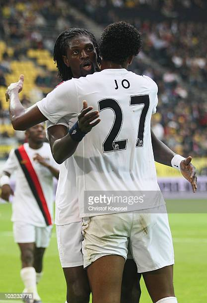 Jo of Manchester City celebrates his first goal with Emanuel Adebayor during the preseason friendly match between Borussia Dortmund and Manchester...