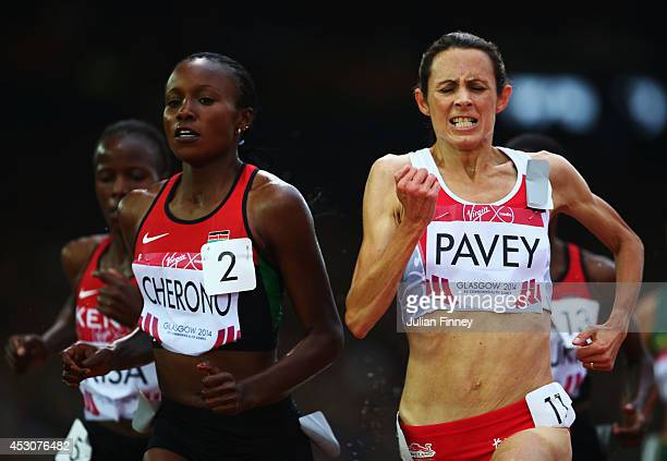 Jo Pavey of England and Mercy Cherono of Kenya lead the pack in the Women's 5000 metres final at Hampden Park during day ten of the Glasgow 2014...