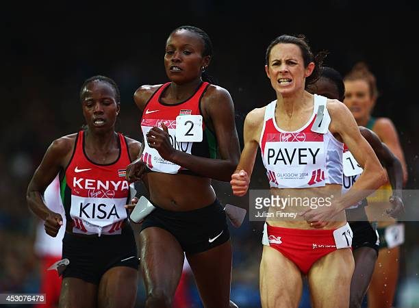 Jo Pavey of England Janet Kisa of Kenya and Mercy Cherono of Kenya lead the pack in the Women's 5000 metres final at Hampden Park during day ten of...