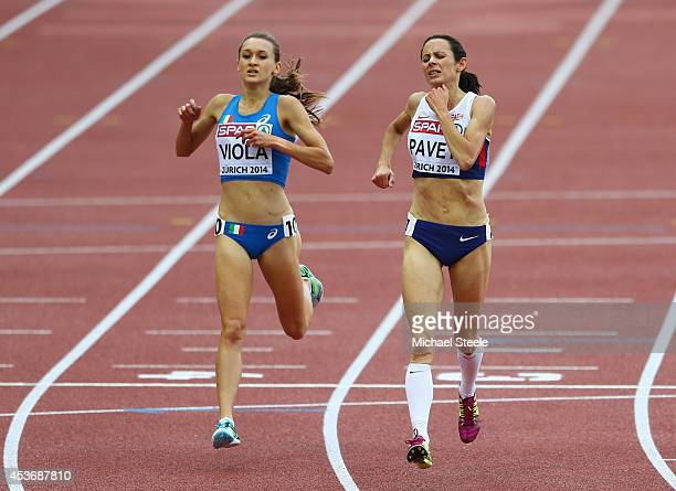 Jo Pavey of Great Britain and Northern Ireland and Giulia Viola of Italy react after the Women's 5000 metres final during day five of the 22nd...