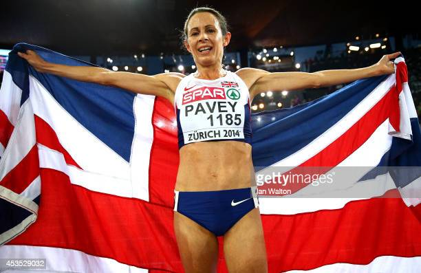 Jo Pavey of Great Britain and Northern Ireland poses with a Union Jack after winning gold in the Women's 10000 metres final during day one of the...