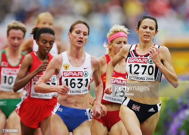 Jo Pavey of Great Britain competes with Liliya Shobukhova of Russia during the Women's 5000 Metres Final on day six of the 19th European Athletics...