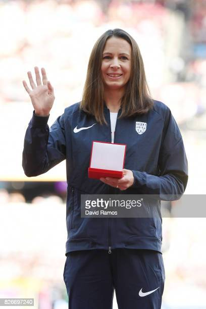 Jo Pavey of Great Britain recieves her reallocated bronze medal from the 10000m Women race at the Osaka 2007 championships during day two of the 16th...