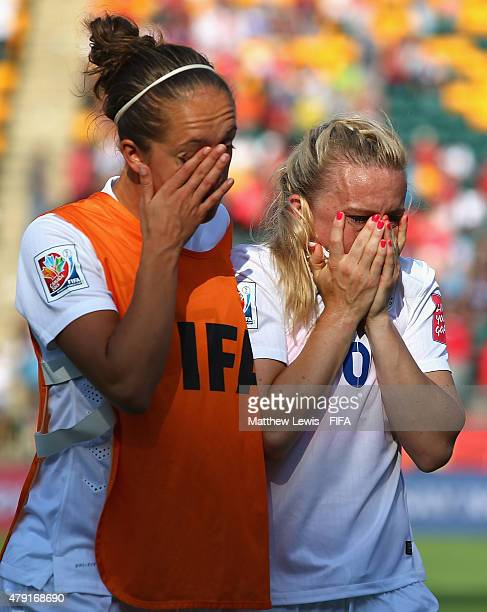 Jo Potter of England consoles Laura Bassett after their team lost to Japan during the FIFA Women's World Cup 2015 Semi Final match between Japan and...