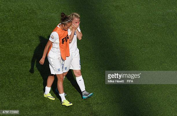 Jo Potter of England tries to console team mate Laura Bassett after her last minute own goal during the FIFA Women's World Cup 2015 Semi Final match...