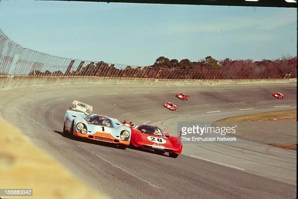 Jo Siffert Brian Redman drive their JW Engineering Gulf Porsche 917 K against Mario Andretti Arturo Merzario Jacky Ickx in their Ferrari 512 S