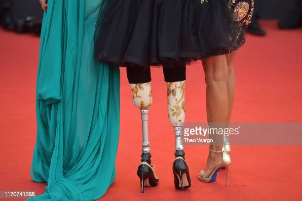 Jo Squillo Giusy Versace and Francesca Carollo detail walk the red carpet ahead of the Opening Ceremony and the La Vérité screening during the 76th...