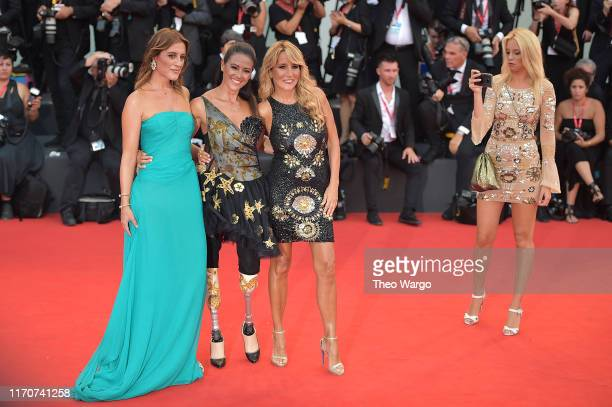 Jo Squillo Giusy Versace and Francesca Carollo walk the red carpet ahead of the Opening Ceremony and the La Vérité screening during the 76th Venice...