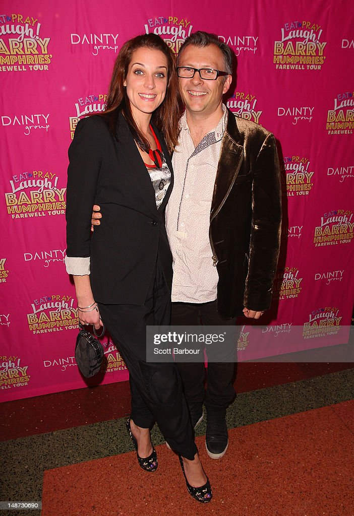 Jo Stanley (L) and her husband Darren McFarlane arrive at the opening night of Barry Humphries' Eat, Pray, Laugh show show at Her Majestys Theatre on July 19, 2012 in Melbourne, Australia.