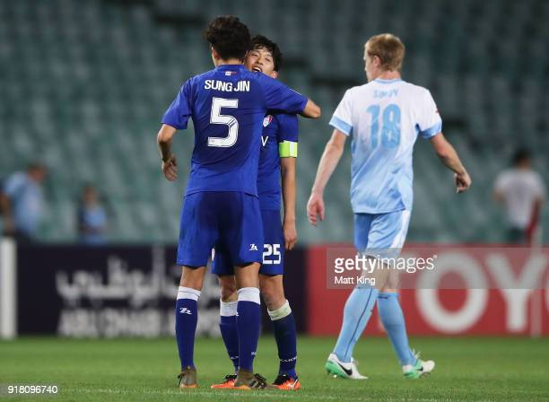 Jo SungJin and Choi SungKuen of the Bluewings celebrate victory during the AFC Asian Champions League match between Sydney FC and Suwon Bluewings at...