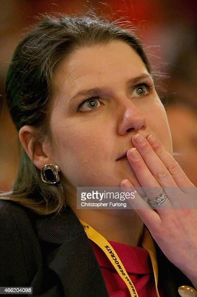 Jo Swinson MP Under Secretary of State for Women and Equalities listens to business secretary Vince Cable delivering his keynote speech during the...