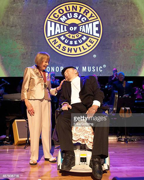 Jo Walker Meador presents Mac Wisemanwith his CMHOF medallion during the 2014 Country Music Hall of Fame induction ceremony at Country Music Hall of...