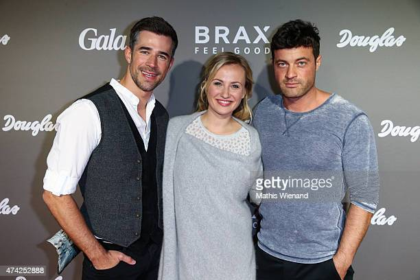 Jo Weil Ania Niedieck Joerg Rohde attend the BRAX Store Opening on May 20 2015 in Cologne Germany