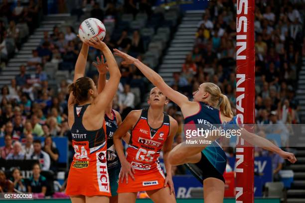 Jo Weston of Melbourne Vixens tries to defend against Susan Pettitt of Giants Netball during the round six Super Netball match between the Vixens and...