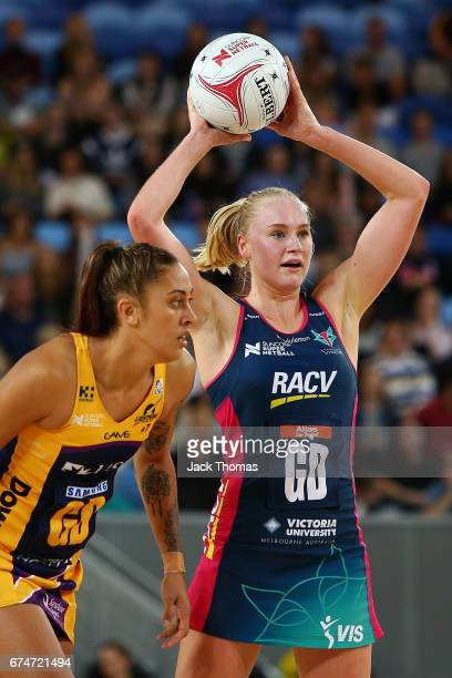 Jo Weston of the Melbourne Vixens looks to pass the ball during the round 10 Super Netball match between the Vixens and the Lightning at Margaret...
