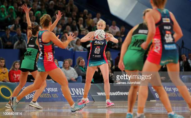 Jo Weston of the Melbourne Vixens looks to pass up the court during the round 13 Super Netball match between the Fever and the Vixens at Perth Arena...