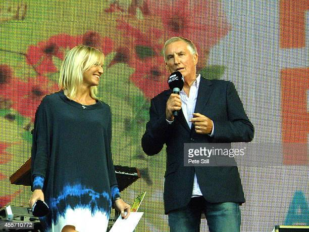 Jo Whiley and Johnnie Walker introduces the bands on stage for BBC Radio 2 Live In The Park at Hyde Park on September 14, 2014 in London, United...