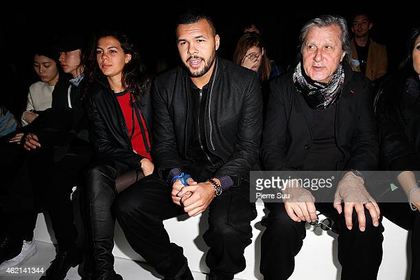 Jo Wilfried Tsonga his girlfriend Noura El Swekh and Ilie Nastase attend the Y3 show Menswear Fall/Winter 20152016 Show as part of Paris Fashion Week...