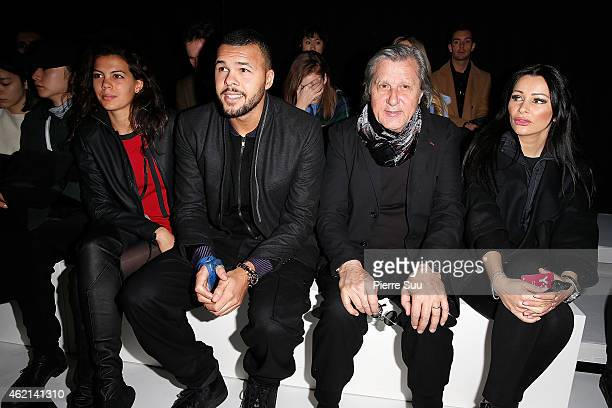 Jo Wilfried Tsonga his girlfriend Noura El SwekhIlie Nastase and his wife Brigitte attend the Y3 show Menswear Fall/Winter 20152016 Show as part of...