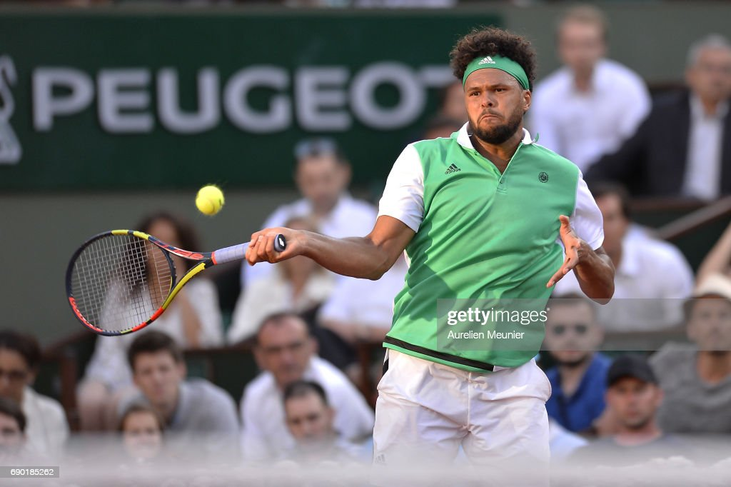 Jo Wilfried Tsonga of France plays a forehand during his men's single match against Renzo Olivo of Argentina on day three of the 2017 French Open at Roland Garros on May 30, 2017 in Paris, France.