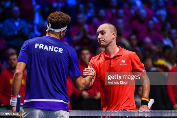 Jo Wilfried Tsonga of France shakes hand with Steve Darcis of Belgium during the day 1 of the Final of the Davis Cup match between France and Belgium...