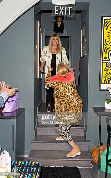 Jo Wood and Brix SmithStart attend Jo Wood's surprise birthday party at L'Escargot on April 17 2015 in London England