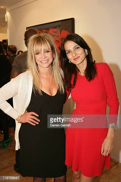 Jo Wood and Yasmin Mills attend the opening of Whisper Gallery on June 9 2011 in London England