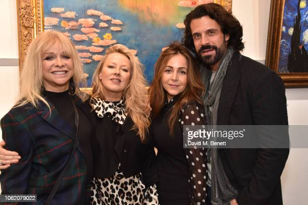 Jo Wood Rhea ElliottJones Laura Adrianna Romanin and Christian Vit attend a private view of artist Paul Karslake's exhibition at The Marylebone...