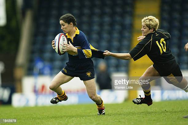 Jo Yapp of Worcester is tackled by Shelley Rae of Wasps during the National Division One League match between the Wasps Ladies and the Worcester...
