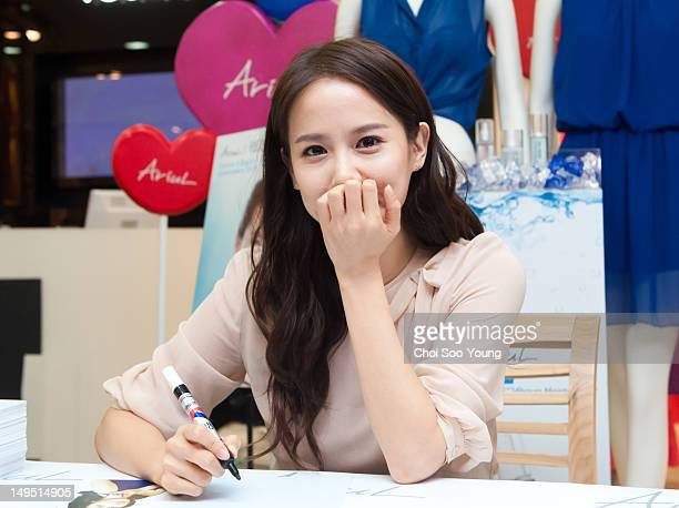 Jo YeoJeong signs autographs during the autograph session collaboration with AriuLat at Hyun Dai Department store on July 1 2012 in Seoul South Korea