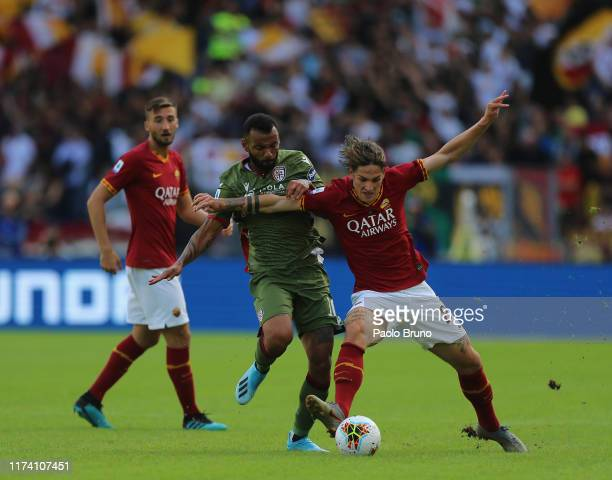 Joa Pedro of Cagliari Calcio competes for the ball with Nicolo' Zaniolo of AS Roma during the Serie A match between AS Roma and Cagliari Calcio at...