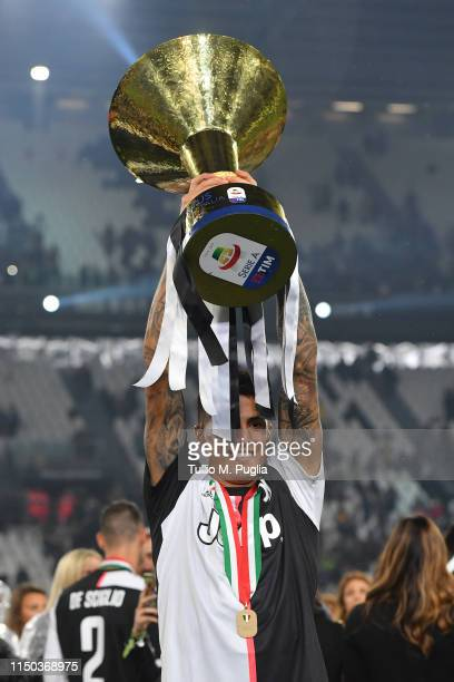 Joaao Cancelo of Juventus celebrates during the awards ceremony after winning the Serie A Championship during the Serie A match between Juventus and...