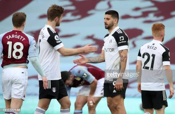 Joachim Andersen and Aleksandar Mitrovic of Fulham shake hands following the Premier League match between Aston Villa and Fulham at Villa Park on...