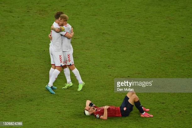 Joachim Andersen and Simon Kjaer of Denmark celebrate their side's victory as Tomas Soucek of Czech Republic looks dejected after the UEFA Euro 2020...