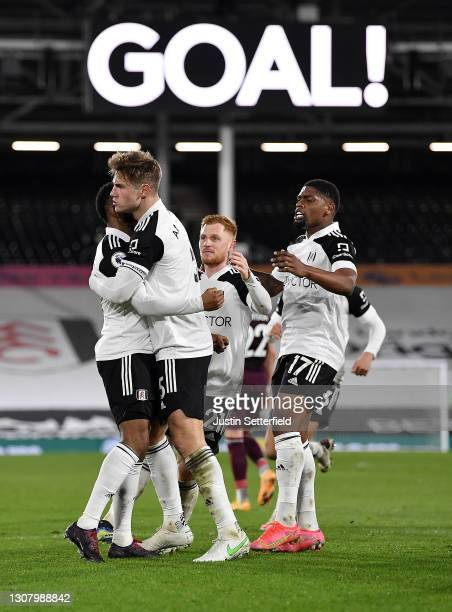Joachim Andersen of Fulham celebrates with teammates Ademola Lookman, Harrison Reed and Ivan Cavaleiro of Fulham after scoring their team's first...