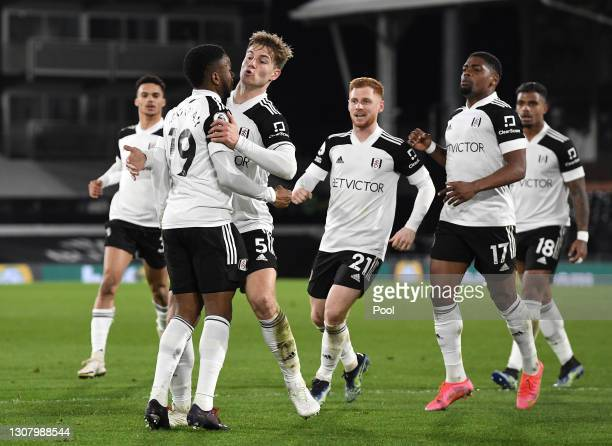 Joachim Andersen of Fulham celebrates with teammates Michael Hector, Ademola Lookman, Harrison Reed, Ivan Cavaleiro and Mario Lemina of Fulham after...