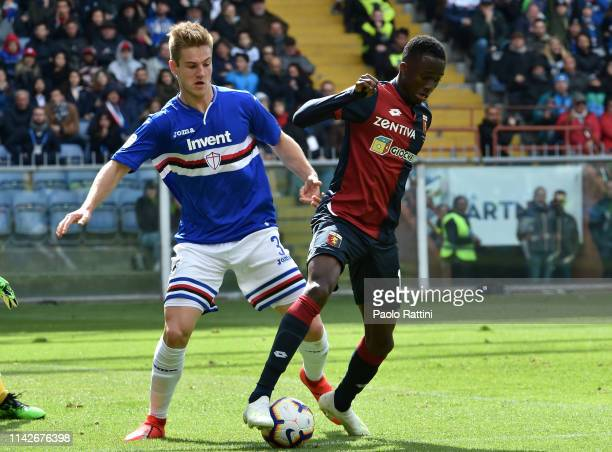 Joachim Andersen of UC Sampdoria and Christian Kouame of Genoa CFC during the Serie A match between UC Sampdoria and Genoa CFC at Stadio Luigi...