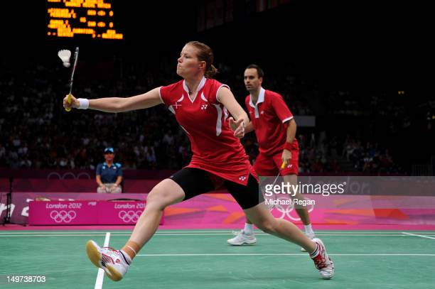 Joachim Fischer and Christinna Pedersen of Denmark compete in the Mixed Doubles Badminton Bronze Medal match against Tontowi Ahmad and Liliyana...