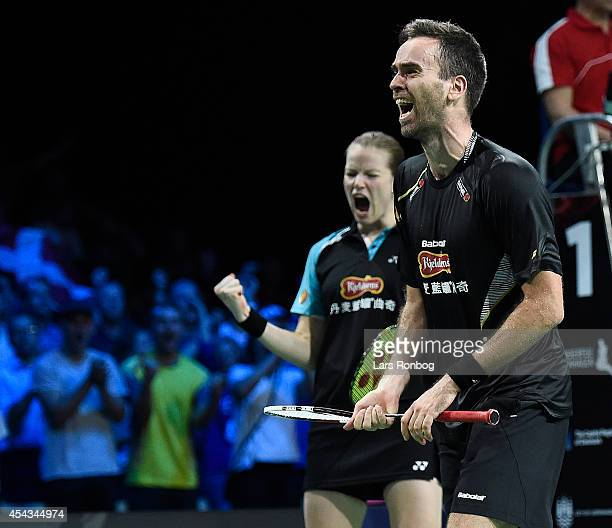 Joachim Fischer Nielsen and Christinna Pedersen of Denmark celebrate winning their match against Praveen Jordan and Debby Susanto of Indonesia during...