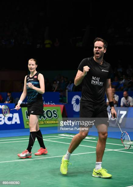 Joachim Fischer Nielsen and Christinna Pedersen of Denmark compete against Tang Chun Man and Tse Ying Suet of Hong Kong during Mixed Doubles Round 1...