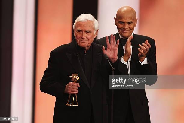 Joachim Fuchsberger recieves the award for 'Lifetime Achievement' from Harry Belafonte during the Goldene Kamera 2010 Award at the Axel Springer...