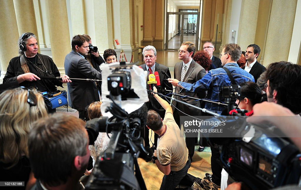 Joachim Gauck (C), candidate of the Social Democrats (SPD) and the Green Party for German president addresses a press conference after a meeting at Berlin's state parliament house on June 16, 2010. The new German head of state, whose job is mostly ceremonial but who acts as a kind of national moral arbiter, is not chosen by popular vote but will be elected by a special assembly of MPs and public figures on next June 30.