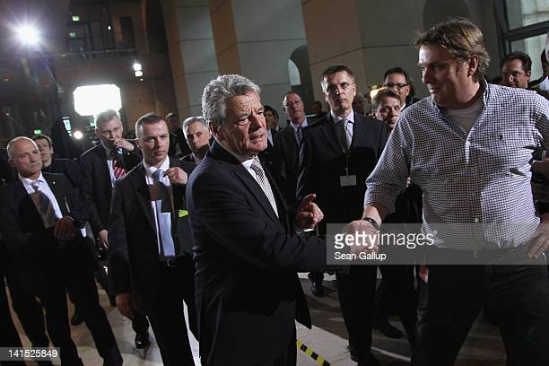 Joachim Gauck Lutheran pastor and former East German humanrights activist greets a supporter as he arrives to speak to television journalists at the...
