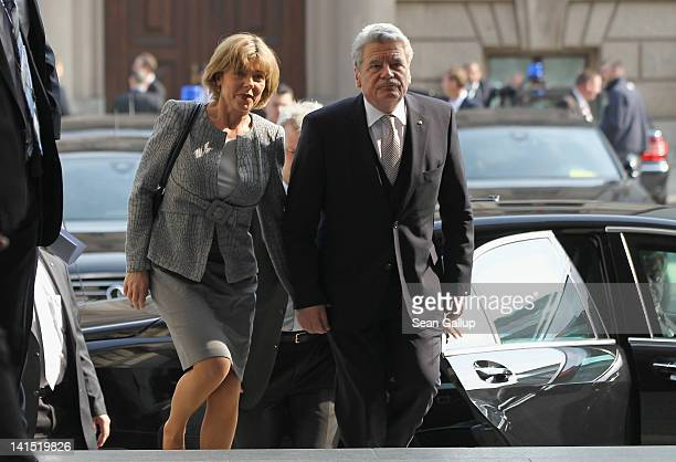 Joachim Gauck Lutheran pastor and former East German humanrights activist and his partner Daniela Schadt arrive at the Bundestag for the election of...