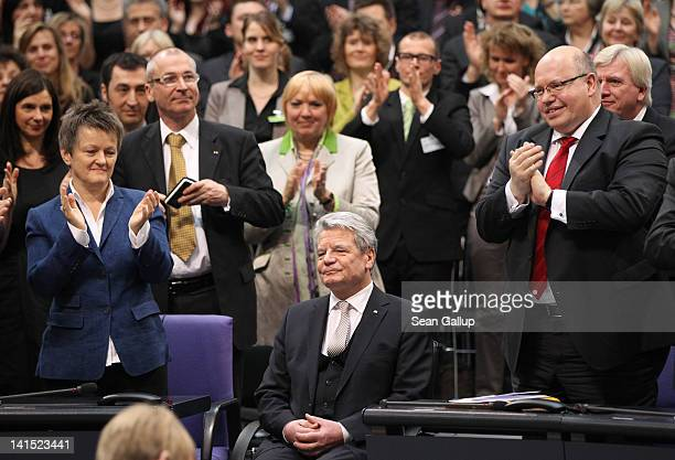 Joachim Gauck Lutheran pastor and former East German humanrights activist is applauded after it was announced that he won the German presidential...