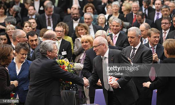 Joachim Gauck Lutheran pastor and former East German humanrights activist is congratulated by Christian Democrat Volker Kauder at the Bundestag after...